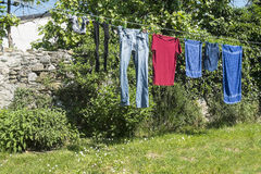 Clothes hung out Stock Images