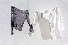 Clothes hung out to dry Stock Photos