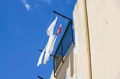 Clothes hung out to dry in the sun in italy Royalty Free Stock Images