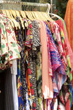 Clothes hung on a rack for sale. Clothes hung on a rack for sale Stock Image