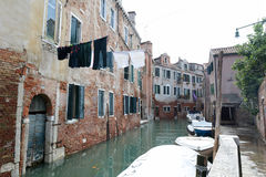 Clothes hung to dry over calm canal in Venice, Italy Royalty Free Stock Photo