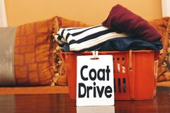 Free Clothes In Orange Basket Or Box With Coat Drive Card Royalty Free Stock Image - 186551426