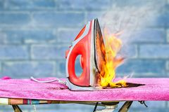 Free Clothes Iron And Ironing Board In The Fire Stock Images - 156740984