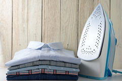 Clothes and iron with wood background Royalty Free Stock Image