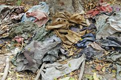 Clothes in the Killing Fields, a memorial to the victims. royalty free stock image