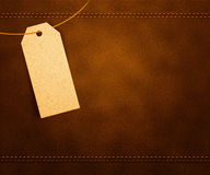 Clothes Label on Leather. Clothes Label on Brown Leather Royalty Free Stock Image