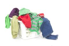 Clothes in laundry basket Royalty Free Stock Images