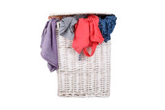 Clothes in Laundry Basket on White Stock Photos