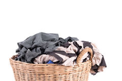 Clothes in a laundry wooden basket Royalty Free Stock Image