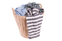 Clothes in a laundry wooden basket Stock Photo