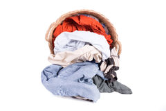 Clothes in a laundry wooden basket Royalty Free Stock Images