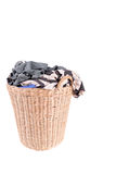 Clothes in a laundry wooden basket Stock Images