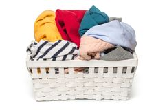 Clothes in a laundry wooden basket isolated on white background royalty free stock photos