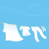 Clothes Line. Colored clothes and natural landscape Royalty Free Stock Photo