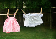 Clothes line. Small child clothes on a line outside Stock Images