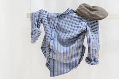 Clothes on a line. A blue, checked shirt on a line Royalty Free Stock Photography