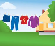 Clothes Line. Conserving energy by drying laundry on a  clothes line in a back yard.  Vector also available Stock Photos