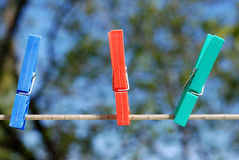 Clothes line. Colorful plastic clothes pins on an outdoor laundry line Royalty Free Stock Photo
