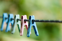 Clothes line. And clothespin on a multi-colored background blur Royalty Free Stock Image