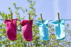 Clothes line with colorful socks Stock Photos