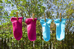 Clothes line with colorful socks Stock Photo