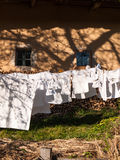 Clothes line full of laundry Stock Photography
