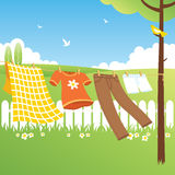 Clothes Line - Garden. Colored clothes and natural landscape Stock Photography