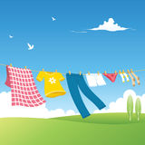 Clothes Line - Garden. Colored clothes and natural landscape Stock Image