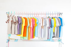Clothes line. Multi-colored T-shirts hanging on a clothes line . After washing done Royalty Free Stock Image