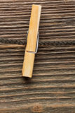 Clothes-line and peg. On wood background stock photography