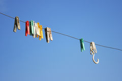 Clothes line with pegs Stock Photography