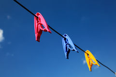 Clothes line and pins Stock Photography