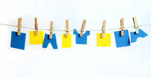 Clothes Line and Pins Holding  blue & Yellow Shapes for Text Royalty Free Stock Image
