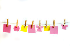 Clothes Line and Pins Holding  Pink & Yellow Shapes for Text Stock Photos