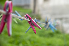 Clothes line with plastic clothes. Pin Stock Images