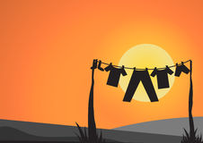 Clothes and line with sun before sunset Royalty Free Stock Photos
