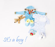 Clothes for a little baby boy  on white background. Blue boy clothing for baby  on white background. It's a boy Stock Photo