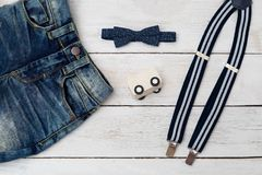 Clothes for little boy dark blue color. Accessories for a little. Gentleman. flat lay Royalty Free Stock Image