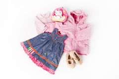 Clothes for little cute girl. Style for a cute little girl, pink clothes with jeans dress isolated on white background Royalty Free Stock Photography
