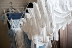 Clothes of little infant baby. Infant clothes, laundry hanging and drying Stock Images