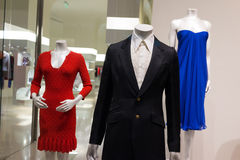Clothes on mannequins. On display in showcase Stock Photos