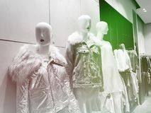 Clothes on a mannequins in a shop. Modern shopping mall Stock Images