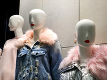 Clothes on a mannequins in a shop. Modern shopping mall Stock Photo