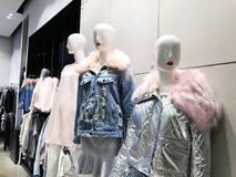 Clothes on a mannequins in a shop. Modern shopping mall Royalty Free Stock Image