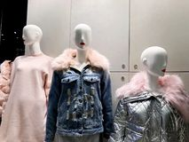 Clothes on a mannequins in a shop. Modern shopping mall Royalty Free Stock Photo
