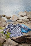 Element of decor in marine style,. Clothes in marine style on sea beach royalty free stock images