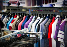 Clothes for men on a hanger in shop Stock Image