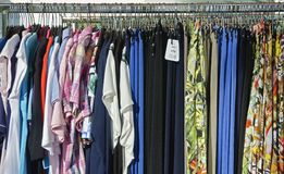 Clothes on a mobile clothes hanger Stock Images