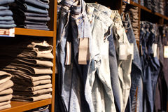 Clothes in the modern retail store Stock Image