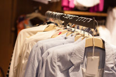 Clothes in the modern retail store. Jeans and clothes in the modern retail store stock photography